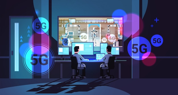Two engineers looking at monitors robot production modern factory robotic industry 5g online wireless connection concept