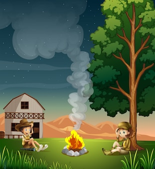 Two explorers making a campfire
