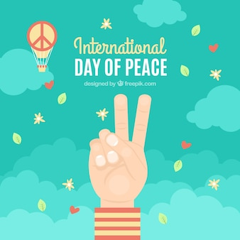 Two fingers, confetti and peace symbo