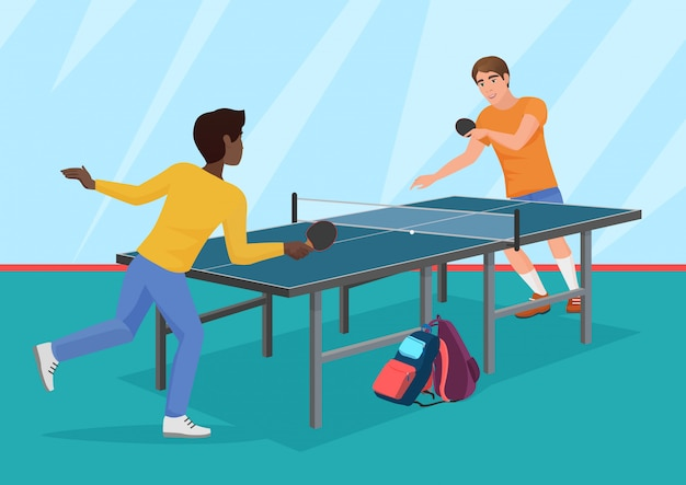 Two friends playing the table tennis.