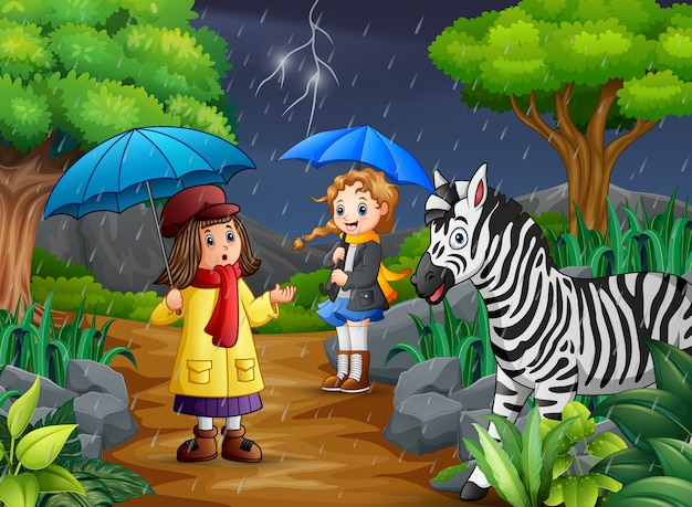 Two girl carrying umbrella goes under a rain with zebra