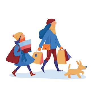 따뜻한 옷을 입은 두 여자 친구와 겨울 세일, 쇼핑, 많은 쇼핑백과 구매를 마치고 집으로가는 개