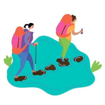 두 소녀가 시내 돌을 따라 하이킹을 갑니다. 여름 하이킹 여행에 영감을 줍니다.