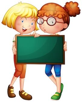 グリーンボードを持っている2人の女の子