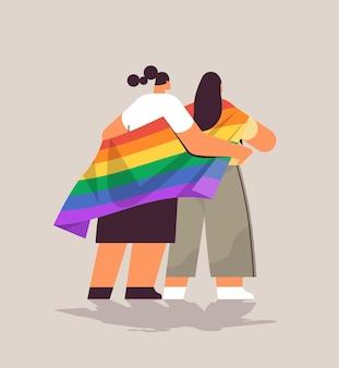 Lgbtレインボーフラッグゲイレズビアン愛パレードプライドフェスティバルトランスジェンダー愛の概念の完全な長さのベクトル図を保持している2人の女の子