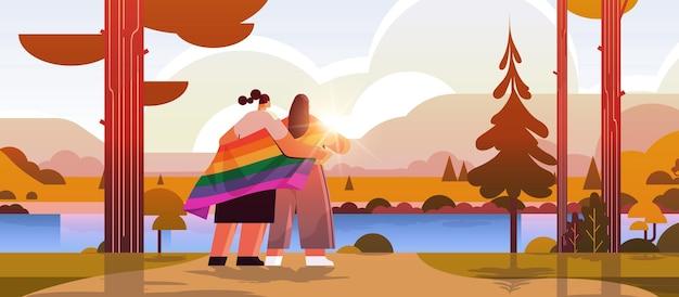 Lgbtレインボーフラッグゲイレズビアン愛パレードプライドフェスティバルトランスジェンダー愛の概念風景背景水平全長ベクトルイラストを保持している2人の女の子