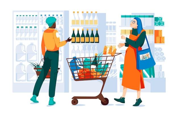 와인을 선택하는 상품으로 가득 찬 트롤리가 있는 슈퍼마켓의 두 소녀 냉장고 선반을 보여줍니다