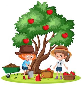 庭でリンゴを拾う二人の女の子