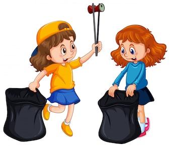 Two girls picking up trash
