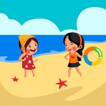 2人の女の子がビーチで遊ぶ