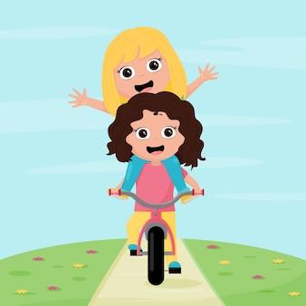 두 여자는 자전거와 함께 야외 놀이