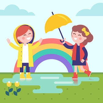 Two girls playing in the rain and rainbow