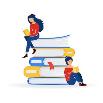 책 더미에 앉아 교육 교육 문학 축제의 개념을 읽는 두 소녀