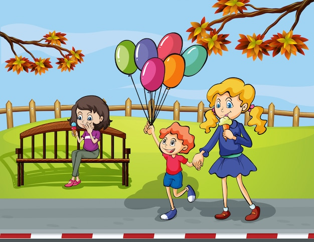 Two girls with a kid holding a balloon in the park