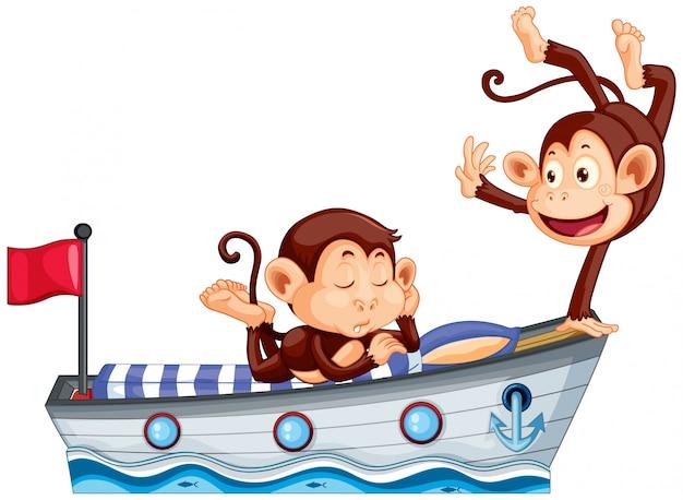 ボートのベッドの上の2つの幸せな猿