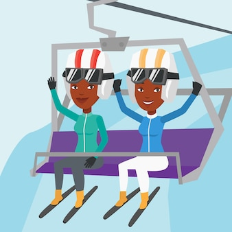 Two happy skiers using cableway at ski resort.
