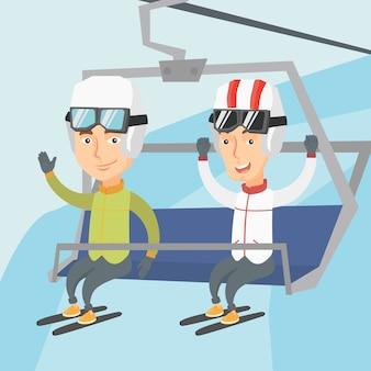 Two happy skiers using cableway at ski resort.