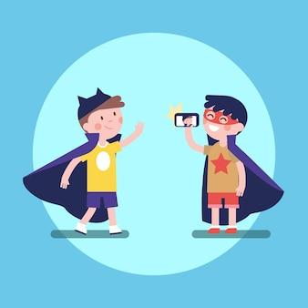 Two kids boys taking photos in superhero costumes