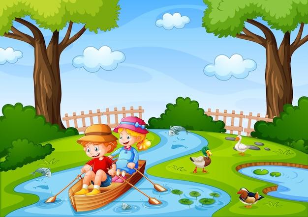 Двое детей гребут на лодке по ручью со своими домашними утками