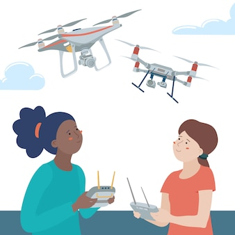 Two kids, teenage girls, black and caucasian, playing with quadcopter drones using remote controllers outdoors
