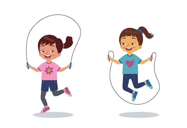 두 어린 소녀가 함께 행복하게 줄넘기를하고있다