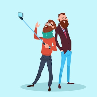 Two man taking selfie photo on smart phone with stick