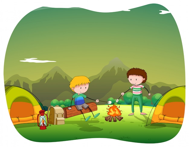 Two men camping out in the field