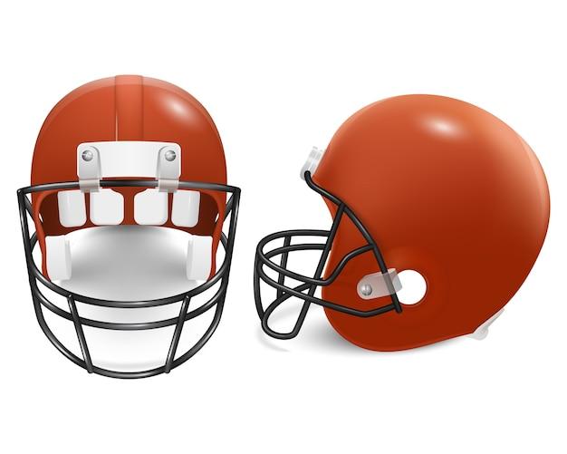 2つのオレンジ色のフットボール用ヘルメット-正面図と側面図。