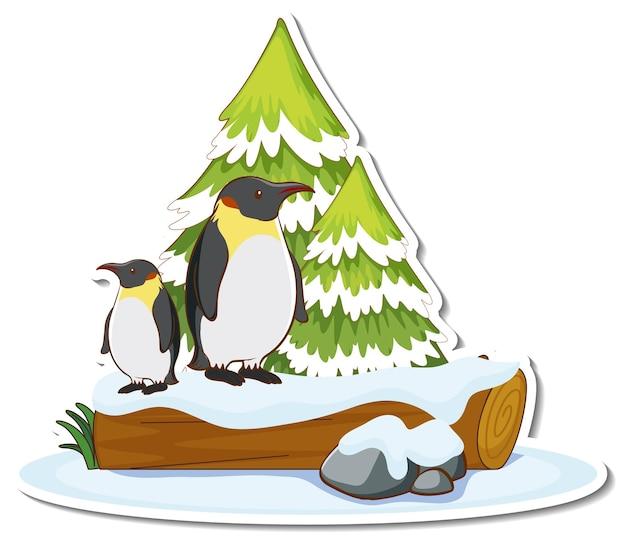 雪のステッカーで覆われた松の木のそばに2羽のペンギンが立っています