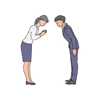 Two people bowing and greeting each other before business meeting