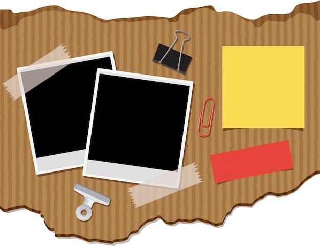 Две фоторамки и блокноты на картонном фоне