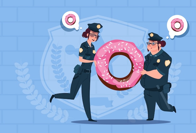 Two police women holding donut wearing uniform female guards on blue bricks background