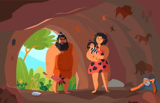Due persone primitive con un bambino nel cartone animato della grotta