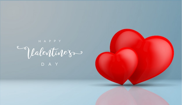 Two red hearts on blue background with reflection and shadow for valentines day background.