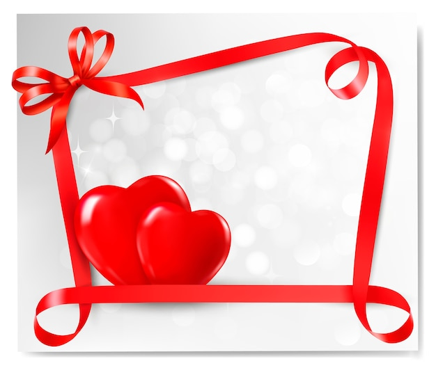 Two red hearts and gift bow and ribbons