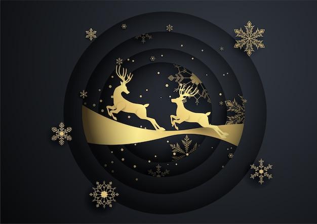 2つのトナカイが金の雪の結晶、メリークリスマス、明けましておめでとうと円を描くようにジャンプします