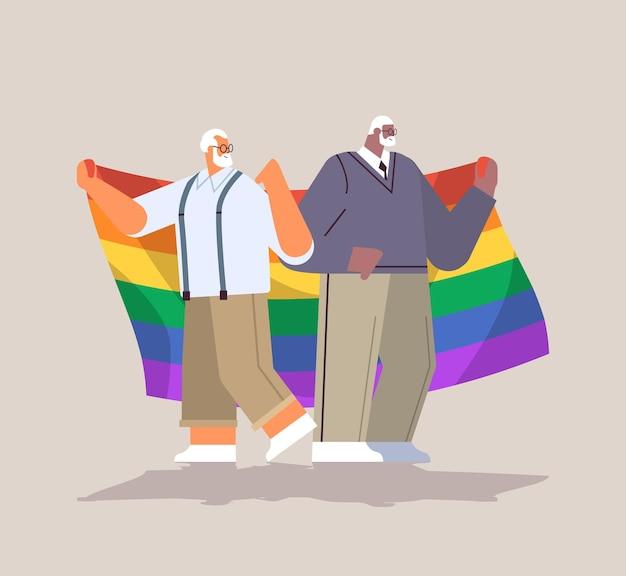 Lgbtレインボーフラッグゲイレズビアン愛パレードプライドフェスティバルトランスジェンダー愛の概念の完全な長さのベクトル図を保持している2人の年配の男性