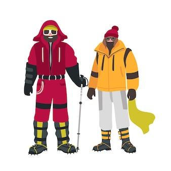 흰색에 고립 된 따뜻한 옷에 특수 장비와 함께 두 웃는 등산가 또는 산악인,