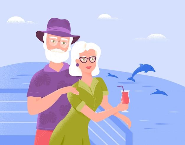 笑顔の2つのシニア配偶者は、さわやかなドリンクを飲みながら船のデッキでリラックスします。
