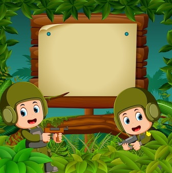 Two soldiers with guns in the jungle