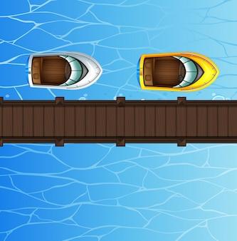 Две скоростные лодки, плавающие у моста