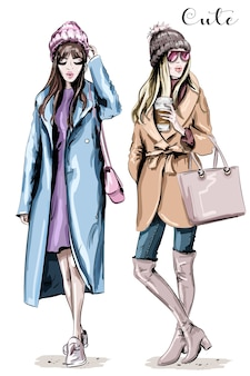 Two stylish beautiful women in winter clothes