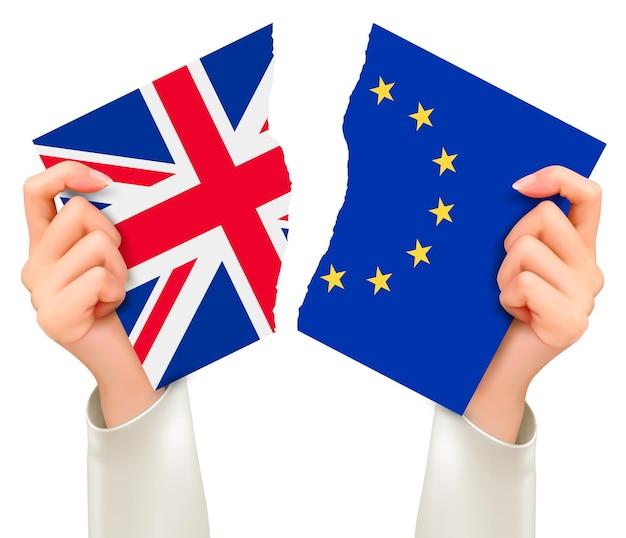 Два порванных флага - ес и великобритания в руках. концепция brexit. вектор.