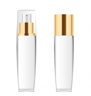 Two transparent cosmetic bottles with golden caps.