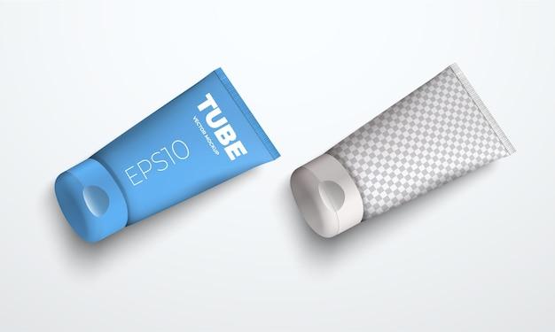 Два векторных макета реалистичной пластиковой трубки для крема или жидкости, лежащей на поверхности. шаблон для дизайна презентационной упаковки. вид сверху