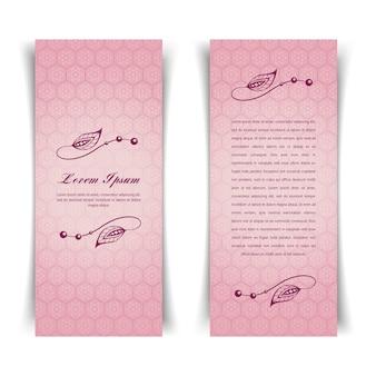 花の要素を持つ2つの垂直ヴィンテージピンクカード