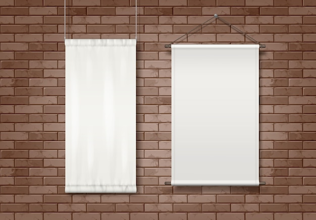Two white blank textile advertising billboards attached to a buildings exterior brick wall.