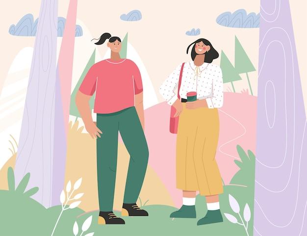 都市公園または森で会う2人の女性。
