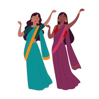 Two women wearing traditional clothing dancing indian dance.