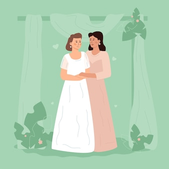 Two women in white dresses are standing embracing. lgbt wedding. two lesbian wives.